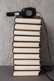 Audiobooks, headphones on book pile