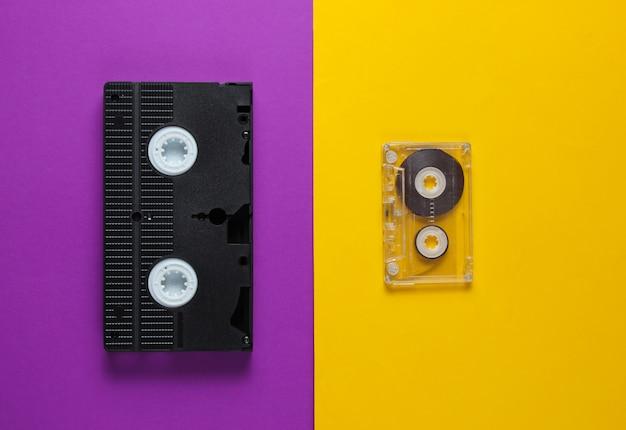 Аудиокассета, видеозапись на пурпурно-желтом фоне