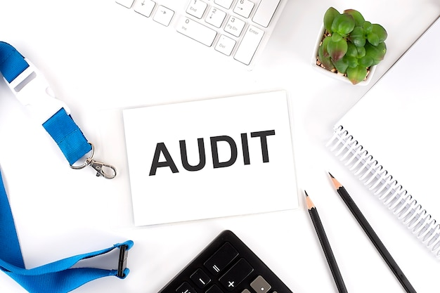 Audit words on the card with keyboard and office tools