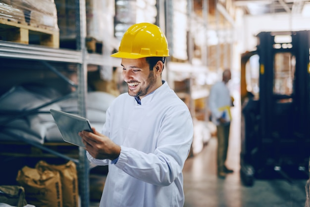 Auditor using tablet in warehouse.