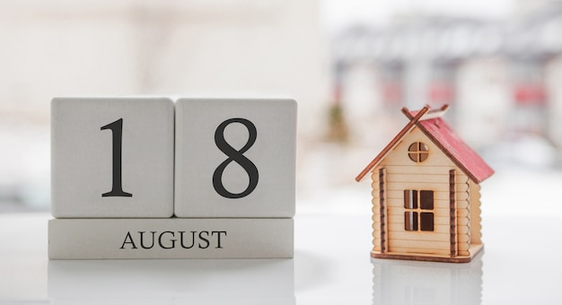 August calendar and toy home. day 18 of month. card message for print or remember