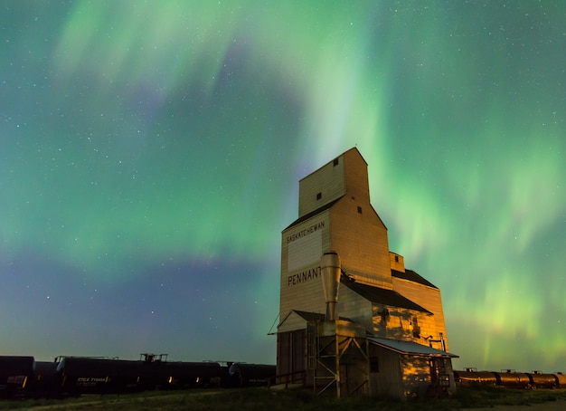 Aurora borealis over a historic grain elevator in pennant, saskatchewan, canada