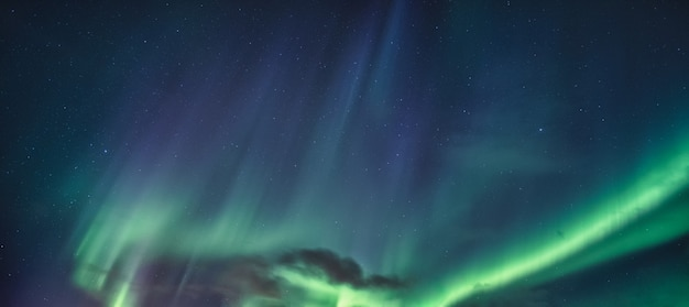 Aurora borealis, northern lights with starry glowing in the night sky