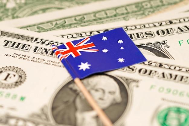 Australia flag on dollar banknotes background.