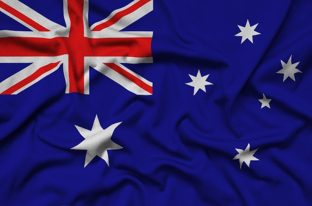 Australia flag is depicted on a sports cloth fabric with many folds.