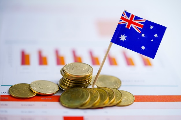 Australia flag with coins on graph background.