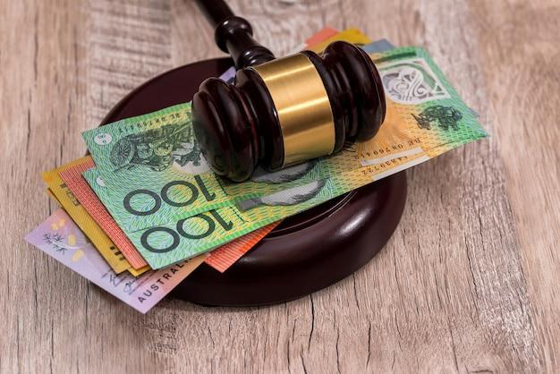Australian dollars under judge's gavel close up