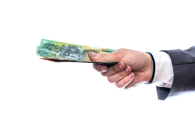 Australian dollars in male hand isolated on white