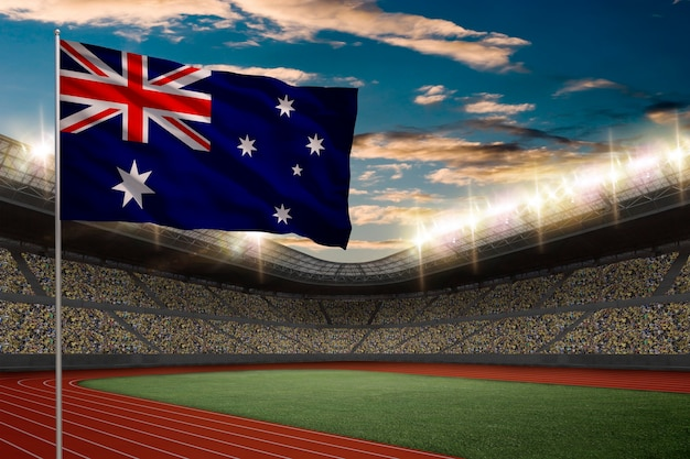 Australian flag in front of a track and field stadium with fans.