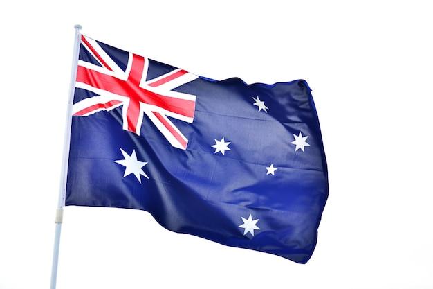 白い背景に動く波とオーストラリアの旗