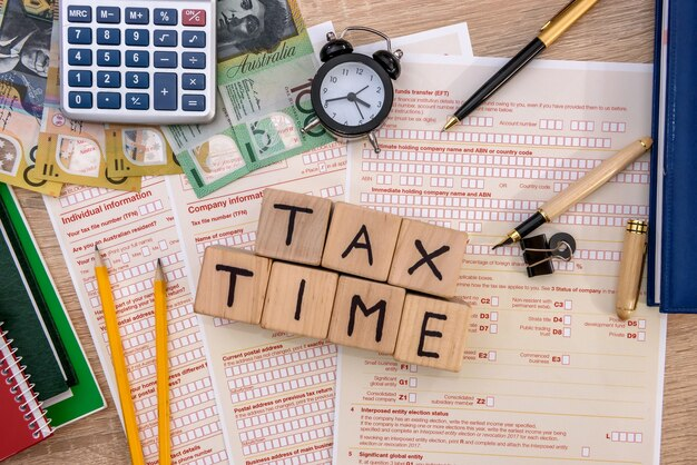 Australian tax time, tax form with money on table
