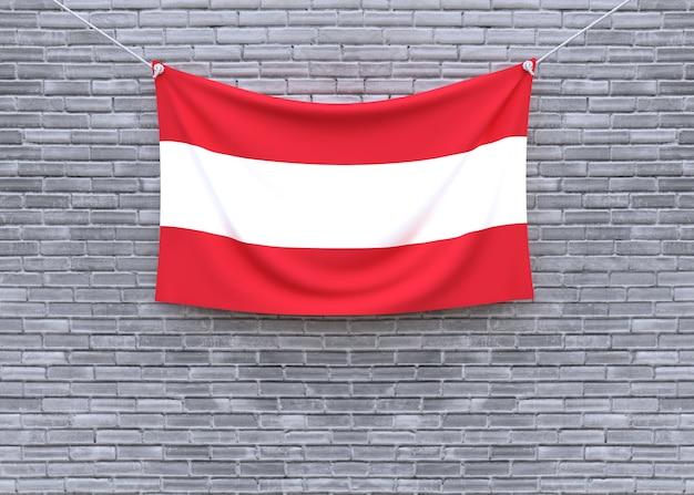 Austria flag hanging on brick wall