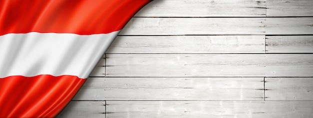 Austria flag on old white wall. horizontal panoramic banner.