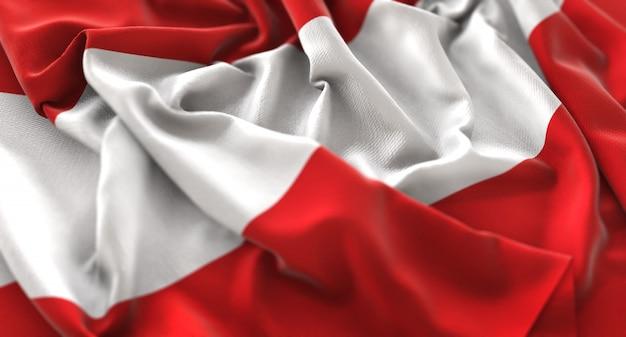 Austria flag ruffled beautifully waving macro close-up shot