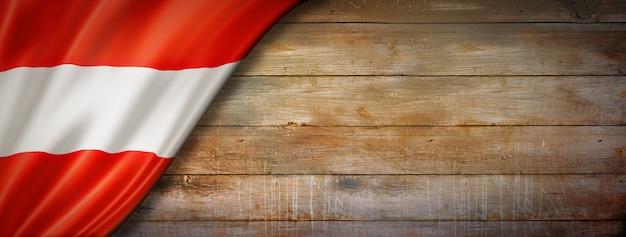 Austria flag on vintage wood wall. horizontal panoramic banner.
