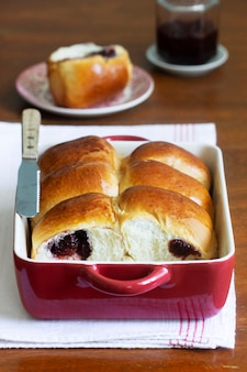 Austrian buns with cherry filling in a baking dish. rustic style, selective focus.