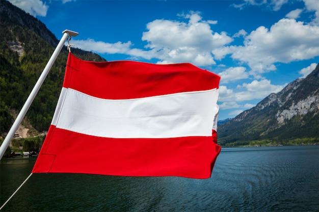 Austrian flag agains mountain lake