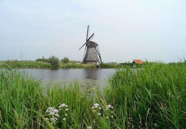 Authentic dutch windmill at kinderdijk windmill complex, molenwaard, south holland