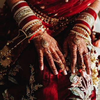 Authentic indian wedding bracelets and colored hands by henna