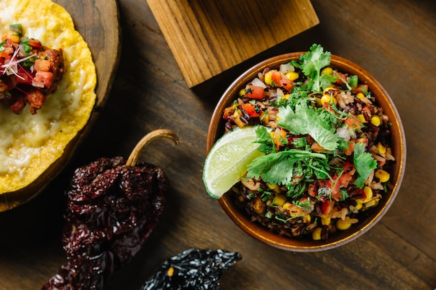 Authentic mexican rice (arroz rojo) mix with rice berry, tomato and corn.