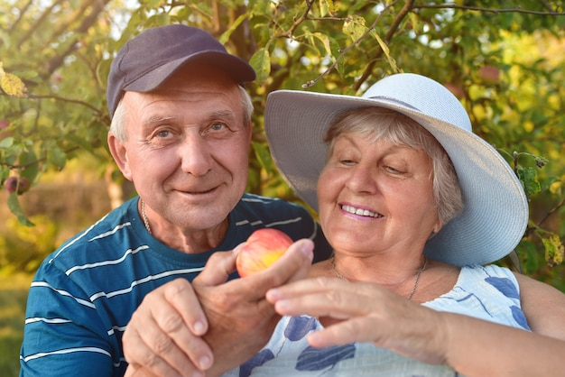 Authentic outdoor shot of aging couple having fun in the garden and blessed with love