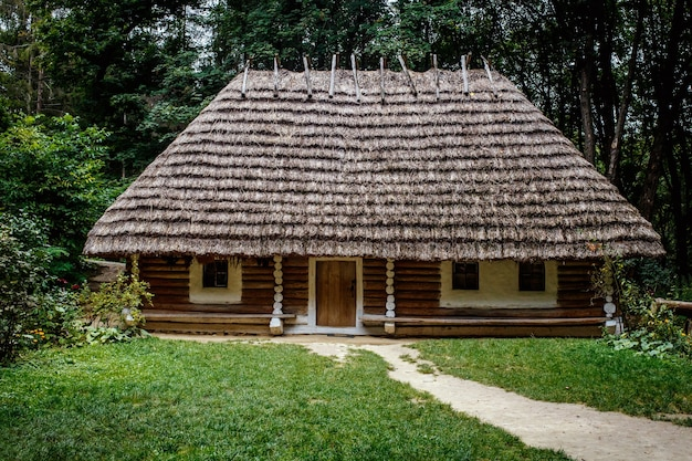 Authentic ukrainian wooden houses with thatched, straw roof