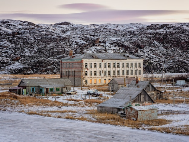 Authentic village of teriberka in the north of russia. the building of an old abandoned school