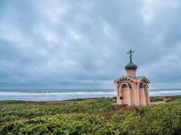 Authentic wooden chapel of the monk tersky on the white sea coast. kola peninsula. russia.