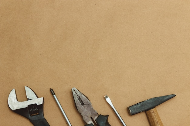 Authentic worn various tools on border background