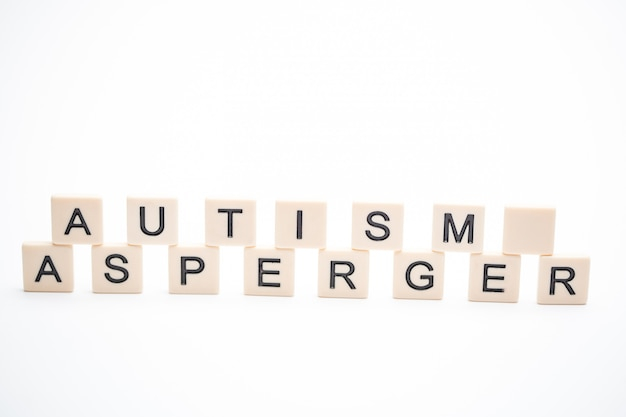 Autism and asperger spelled out in plastic letter pieces