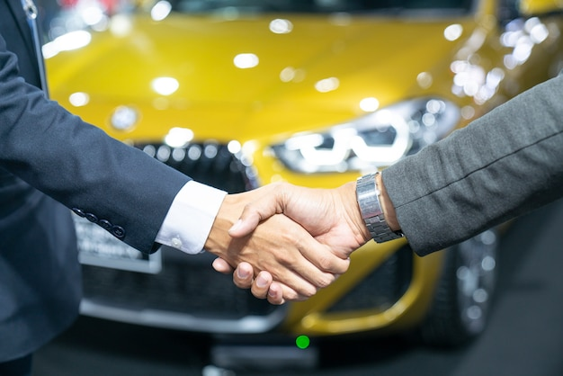 Auto business, car sale, deal, gesture and people concept