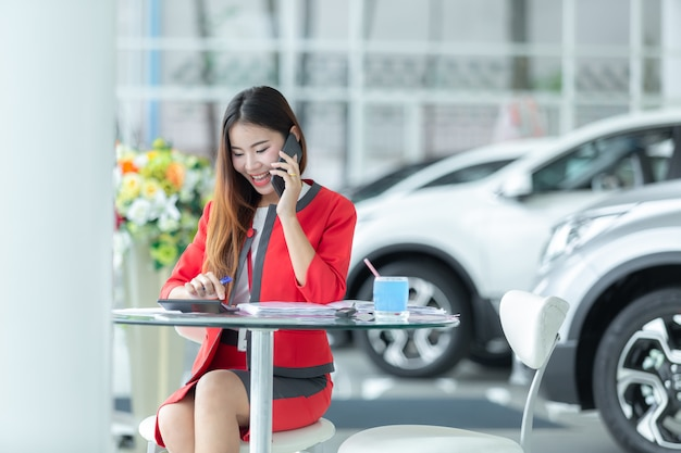 Auto business, car sale, gesture and people concept - smiling businessman.