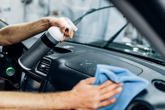 Auto detailing of car interior on carwash service.