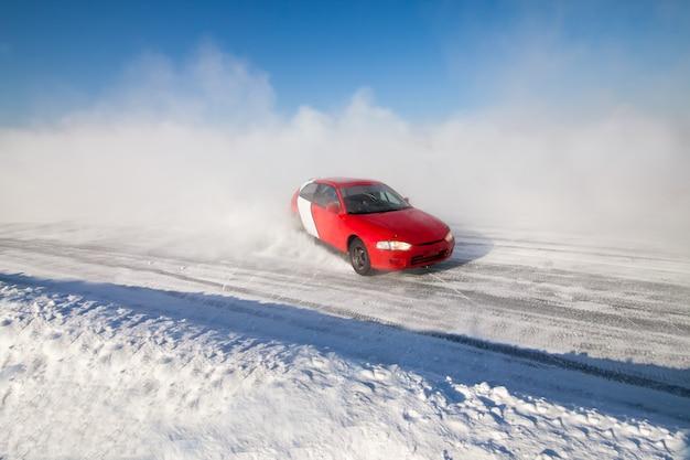 Auto ice racing on the frozen lake