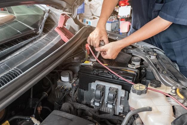 Auto mechanic repairing in a engine car
