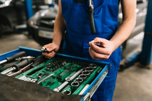 Auto mechanic's hand holding spanners