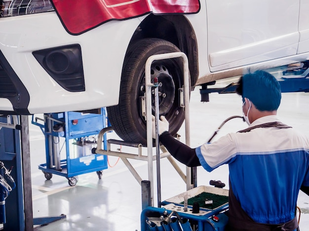 Auto mechanic working in car service centre