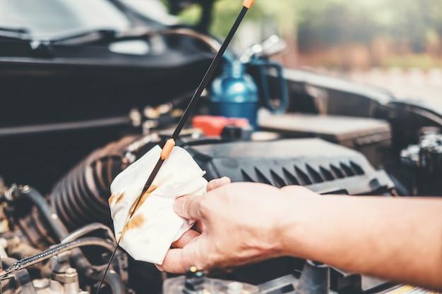 Auto mechanic working in garage technician hands of mechanic oil check mechanic