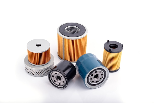Auto parts accessories :  oil , fuel or air filter for engine car  isolated