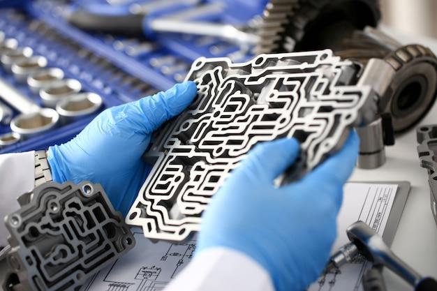 The auto repair service repairman in automatic