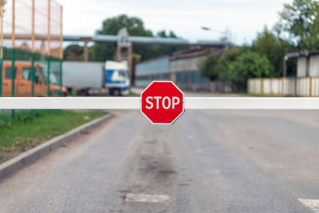 Automatic barrier with a stop sign.