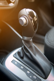 Automatic gear stick of modern car. interior of car close up