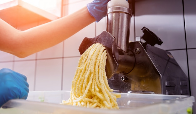 Automatic grater cheese for khachapuri or pizza or pasta.