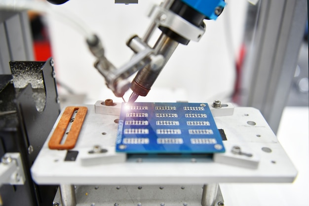 Automatic robot for print circuit board assembly machine during soldering component at factory