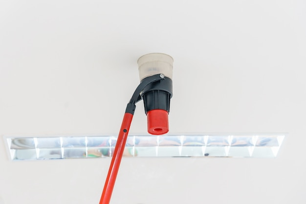Automatic smoke detector fire alarm head on the ceiling.