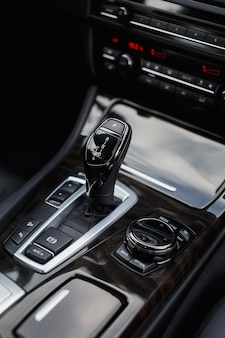 Automatic transmission gear shift in modern car close up