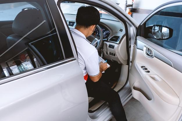 Automobile mechanic repairman checking a car