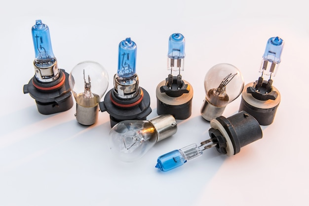 Automotive headlamp bulb for repair isolated on white. modern light car lamp