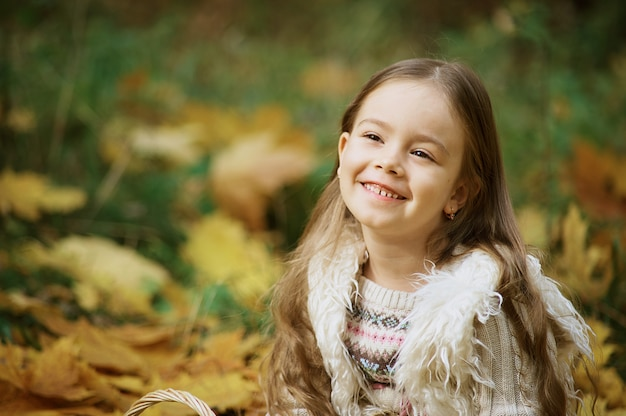 Autumn activities for children. laughing girl. little child in autumn park