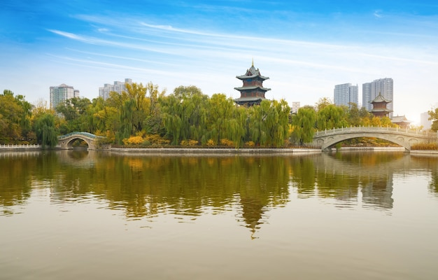 In autumn, ancient buildings and arch bridges are in yingze park, taiyuan, shanxi province, china